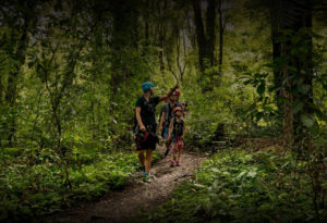 Family-walking-through-forest
