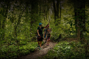 Guide-leading-family-through-forest