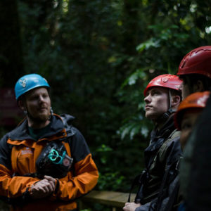 Guide-talking-to-people-in-helmet