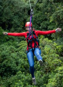 Woman-smiling-on-zipline
