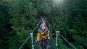 People-walking-on-swingbridge