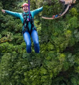 Woman-on-zipline-above-forest-people-on-walkway-above-forest